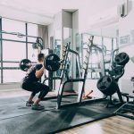 Alt: A person doing squats at the gym